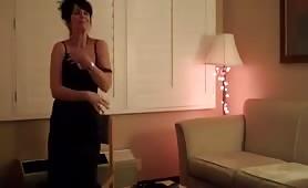 Fine lookin' broad does a sexy little striptease.