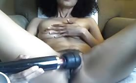 Mature Small Tits Plays with Hairy Pussy