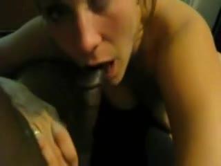 Two black girls sucking on a big black cock.